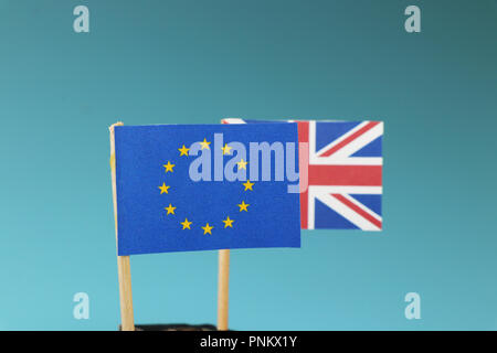 Flag of European union and flag of Great Britain in background. Showing brexit in live stream. Blue background - Stock Photo