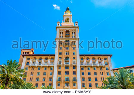 The Miami Biltmore Hotel in Coral Gables.  Facade in clear blue sky. The old vintage building is a luxury hotel and it is listed as a National Histori - Stock Photo