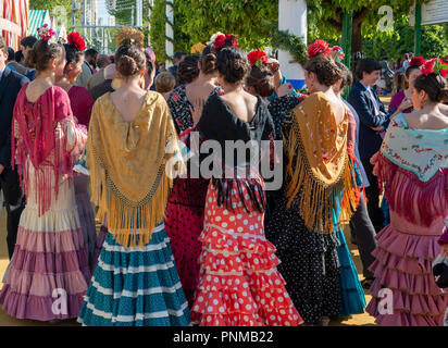 Spanish women with colorful flamenco dresses, Feria de Abril, Sevilla, Andalusia, Spain - Stock Photo