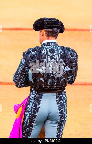 Matador, Torero or Toureiro in traditional clothing, bullfighting in an arena, Plaza de Toros de la Real de Maestranza de - Stock Photo
