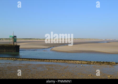 Looking east to Camber Sands at low tide from Rye Harbour mole, East Sussex, England, UK, late on a summer day - Stock Photo