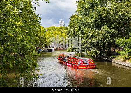 Amsterdam, Netherlands - August 10, 2018 - Hop on Hop off boat in Canal in Amsterdam - Stock Photo