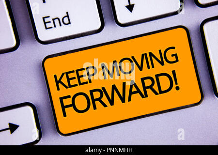 Word writing text Keep Moving Forward Motivational Call. Business concept for Optimism Progress Persevere Move Silvery keyboard yellow button two arro - Stock Photo