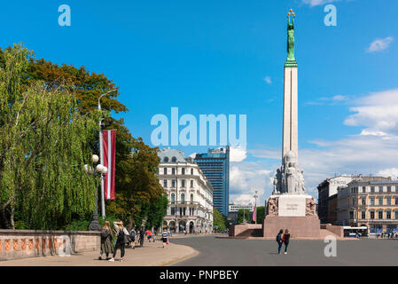Freedom Monument Riga, view of Freedom Square in summer with its centrepiece Freedom Monument column rising 42 metres above the city of Riga, Latvia. - Stock Photo