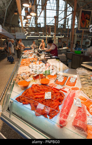 A display of fresh sturgeon roe - red caviar - on display in the fish hall in the Riga Central Market, Latvia. - Stock Photo