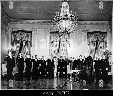 August 24, 2001 - Washington, District of Columbia, U.S. - Swearing-In Ceremony of United States President John F. Kennedy's Cabinet in the East Room of the White House on January 21, 1961. U.S. Chief Justice Earl Warren administers Oath to (L-R) Dean Rusk, Secretary of State; Douglas Dillon, Secretary of the Treasury; Robert S. McNamara, Secretary of Defense; Robert F. Kennedy, Attorney General; J. Edward Day, Postmaster General; Stewart Udall, Secretary of Interior; First Lady Jacqueline Kennedy; U.S. President John F. Kennedy; Adlai E. Stevenson, U.S. Representative to the United - Stock Photo