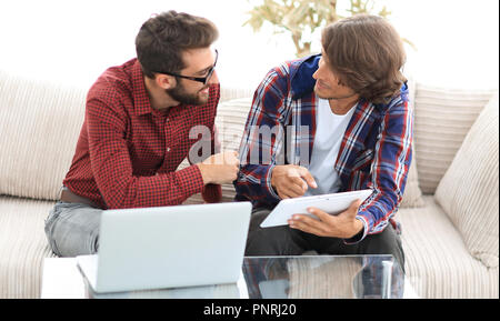 creative web designers working with a tablet and a laptop. - Stock Photo