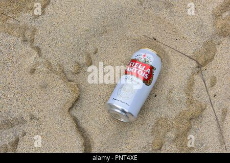 Discarded can of stella artois on a UK sandy beach - Stock Photo