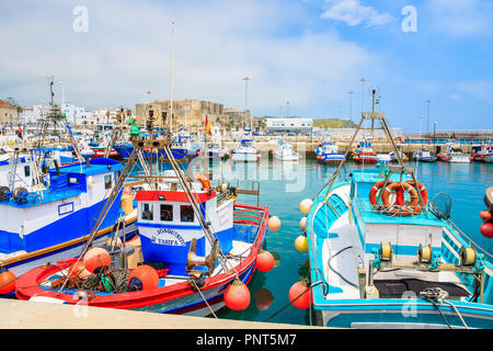 TARIFA PORT, SPAIN - MAY 8, 2018: Fishing boats anchoring in coastal town of Tarifa on Costa de Sol. Spain is second most visited country in Europe. - Stock Photo
