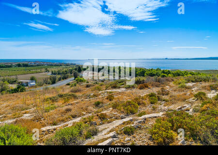 View from the shore at a small fishing village on the Mediterranean Sea in the French village of Gruissan in the South of France - Stock Photo