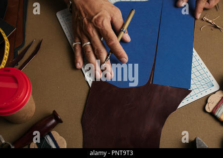 Working process of producing hand made leather wallet in the leather workshop. - Stock Photo