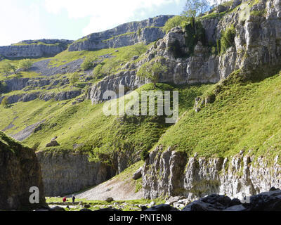 The entrance to Gordale Scar with its limestone cliffs, near Malham, in the Yorkshire Dales, UK - Stock Photo