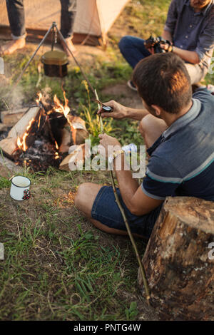 tourist is preparing tools for fishing - Stock Photo