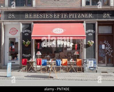 Café Hygge on a sunny and colourful Nørrebrogade, in Copenhagen - Stock Photo