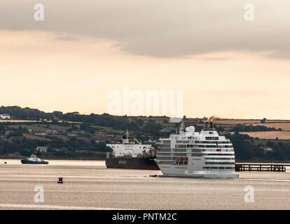 Whitegate, Cork, Ireland. 19th July, 2018. Cruise ship Seven Seas Navigator  passing the crude oil tanker Shah Deniz at Whitegate while on her way to  - Stock Photo