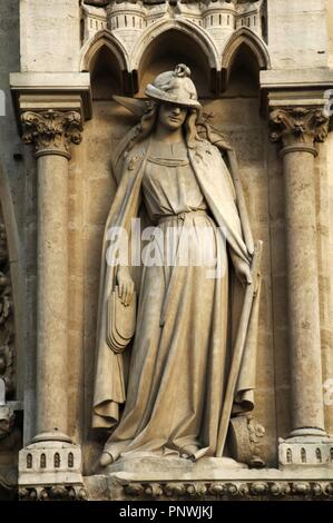 France. Pari_s. Notre Dame cathedral. Portal of St. Anne. Synagogue. AllegorycaI statue depicted with his eyes covered, her crown falling on the floor, the tables of the law reversed, falling from his hand, and holds a  banner of Judaism, which is broken. The dejected pose try to suggest defeat. Stock Photo