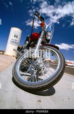 USA. Arizona, Kingman, Route 66. Low viewpoint close up of classic Harley-Davidson motorcycle. - Stock Photo