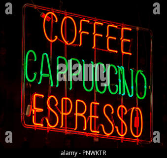 A neon sign in a cafe for differnt types of coffee on sale - Stock Photo