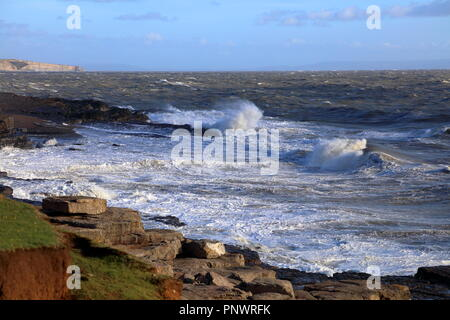 High tide at the area known as Ogmore deeps with the high tide waves rolling in and crashing onto the rocks leaving the sea a foaming mass. - Stock Photo
