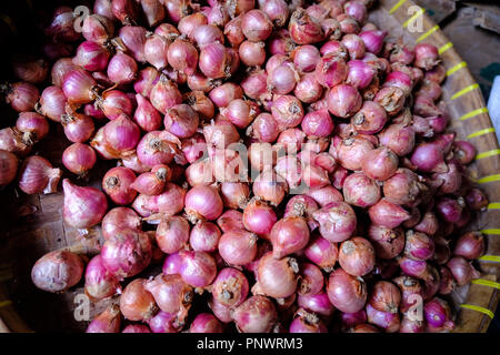 Shallots on sale at a market stall in Bali - Stock Photo