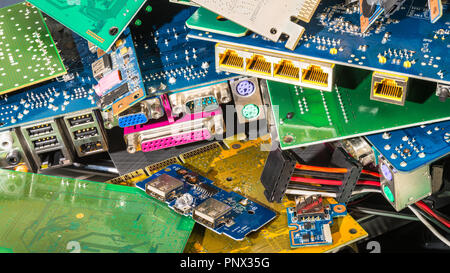 E-waste pile from discarded computer parts. Colorful background from PC components - mainboards, PCB, connectors. Hardware, electronics industry, eco. - Stock Photo