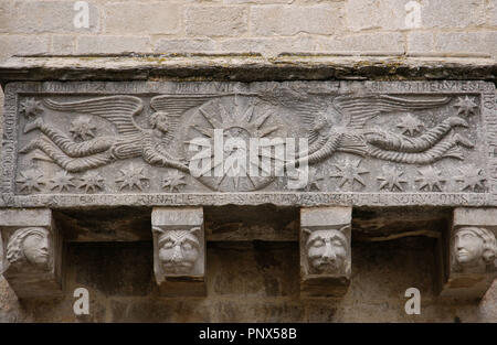 Early Christian Art. Spain. Catalonia. Girona. Collegiate Church of St. Felix. Replica of the sarcophagus which is kept inside the church. It belonged to the Sitjar family. Outside. Wall of the South Nave. On the front, there are two angels holding a circle with a Sun and the Agnus Dei inside. - Stock Photo