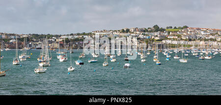 Panoramic view of Falmouth harbourside with colourful buildings and moored boats. - Stock Photo