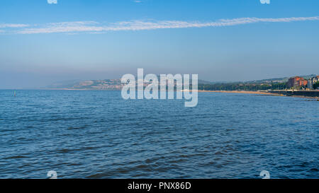 Welsh coast in Rhos-on-Sea with Colwyn Bay in the background, Conwy, Wales, UK - Stock Photo