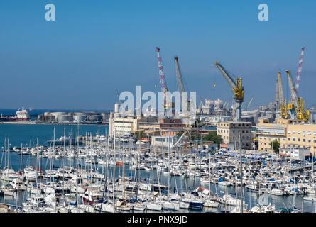 tourist and commercial boats moored in neat rows in the port of Genoa, Liguria. Italy - Stock Photo