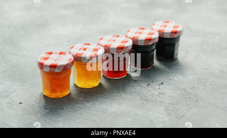 Small cups with different marmalade - Stock Photo