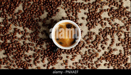 Cup of espresso and coffee beans - Stock Photo