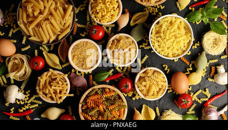 Layout of pasta and ingredients for cooking - Stock Photo