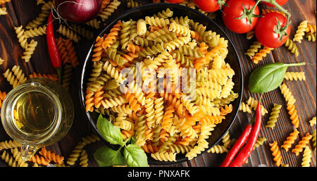 Bowl of uncooked pasta from above - Stock Photo