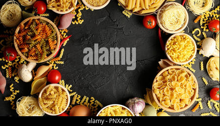 Arranged bowls with pasta assortment - Stock Photo