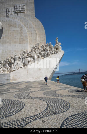 LISBON, PORTUGAL - August 30, 2018: Monument to the Discoveries (Padrao dos Descobrimentos) at the Tagus river with view on 25th of April Bridge - Stock Photo