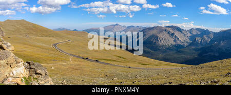 Trail Ridge Road - A panoramic evening view of Trail Ridge Road winding through vast alpine tundra at top of Rocky Mountain National Park, CO, USA. - Stock Photo
