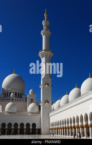 Abu Dhabi, UAE: December 29, 2010: The interior courtyard of the all marble Sheikh Zayed Grand Mosque in the Capital city of the United Arab Emirates. - Stock Photo