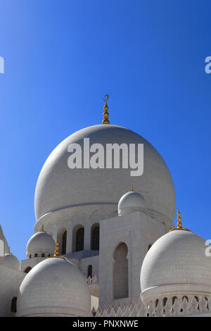 Abu Dhabi, UAE: December 29, 2010: The marble domes over the main section of the Sheikh Zayed Grand Mosque in the Capital city of the UAE. - Stock Photo