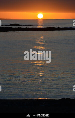 Sunset over Cardigan Bay from the promenade in Aberystwyth, Wales, UK - Stock Photo