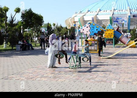 Tashkent, Uzbekistan - May 01, 2017: Unknown kids playing at the premises of circus building. - Stock Photo