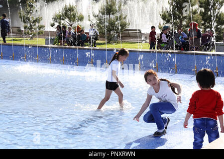 Tashkent, Uzbekistan - May 01, 2017: Unknown children playing in the fountain at the premises of circus building. - Stock Photo