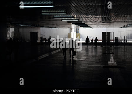 Tashkent, Uzbekistan - May 01, 2017: Silhouette of unknown Uzbek people in the broad subway. - Stock Photo