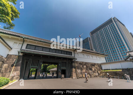 Tokyo, Chiyoda Ward - August 5, 2018 : Tourists passing through  Ote-mon Gate entrance of Imperial Palace East Gardens Ninomaru. Otemon Tower - JX Bui - Stock Photo