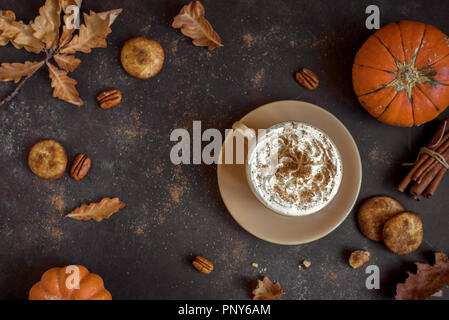 Pumpkin Spice Latte. Cup of Latte with Seasonal Autumn Spices, Cookies and Fall Decor. Traditional Coffee Drink for Autumn Holidays. - Stock Photo