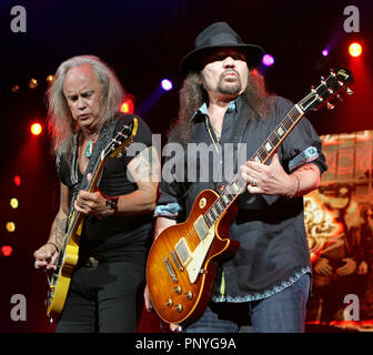 Rickey Medlocke (L) and Gary Rossington with Lynyrd Skynyrd perform in concert at the Cruzan Amphitheater in West Palm Beach, Florida on June 10, 2010. - Stock Photo