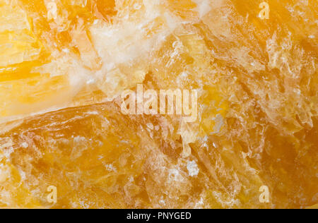 Raw, uncut yellow calcite (CaCO3) from Mexico close up frame filling texture - Stock Photo