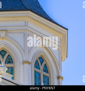 Building with stained glass on arched windows - Stock Photo