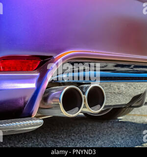 Purple car with dual exhaust pipe - Stock Photo