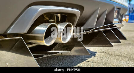 Twin exhaust pipe of a car with rear spikes - Stock Photo
