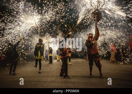Barcelona, Spain. 22 September, 2018:  'Correfocs' (fire runners) set off their fireworks during Barcelona's Fiesta Mayor (main festival), La Merce Credit: Matthias Oesterle/Alamy Live News